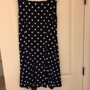 Sleeveless navy and white polka dot dress